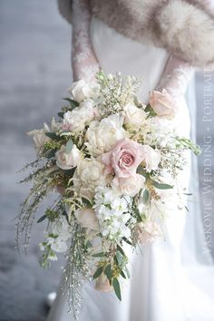 Need a bridal bouquet inspiration for your wedding? Consider the white bridal bouquet. While we love scoping out all of the innovative floral designs that are out there, a white bouquet will forever be timeless. But why white? Cascading Bridal Bouquets, Cascading Wedding Bouquets, Cascade Bouquet, Bride Bouquets, Bridal Flowers, Flower Bouquet Wedding, Floral Wedding, Winter Wedding Bouquets, Wedding Dresses