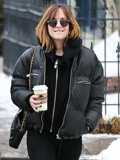 Dakota Johnson was all smiles as she strolled through Colorado in shady syle! Love her vintage-inspired round sunnies!