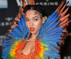 """FKA twigs at the opening of the Alexander McQueen """"Savage Beauty"""" exhibit at Victoria and Albert Museum in London"""