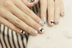 Cute nail art w/ dots and bow tie