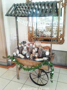 Rustic Candy station Guatemala Dulces tipicos Candy cart wooden carreta candy table baptism first communion primera comunion en guatemala bautismo bautizo wood log garland leaves baby breath  daisies burlap yute rustico  guate la barra dulce siete invitaciones decor wedding barnyard old fashioned