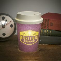 """Having a """"latte"""" night? Let this latte cup night light keep you company. The battery operated lamp includes two cups (the lamp shade), one as pictured and another blank one for you to personalize."""