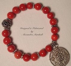 Exciting eye candy! Coral and Tibetan Silver bracelet by Alexandra Marshall. $29.(Item #2023). Double click photo to order.