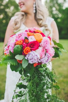 Photo: Teale Photography; Citrus-inspired bridal bouquet with fresh oranges and limes  ... Photo: Teale Photography