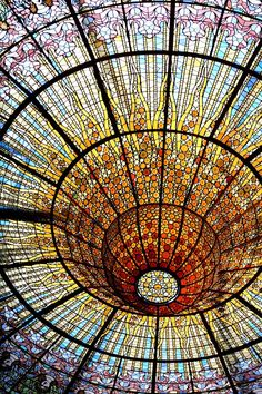 Intricate stained glass roof, opera hall in Barcelona.