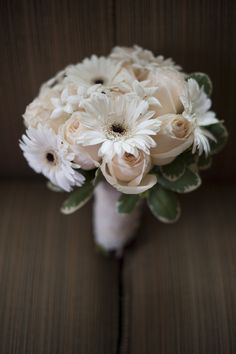 My bouquet... wrapped in lace and adorned with buttons from my Grandmother's wedding dress