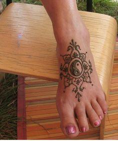 Pretty foot henna tattoo
