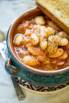 Greek Gigantes - The Wanderlust Kitchen Greek Gigantes are, not surprisingly, GIANT beans! In this recipe, the gigantes are slow cooked in a rich tomato sauce until perfectly creamy and tender. Serve over toasted crusty bread for an easy vegetarian meal! Slow Cooker Recipes, Cooking Recipes, Slow Cooking, Amish Recipes, Dutch Recipes, Cooking Ideas, Greek Cooking, Greek Dishes, Side Dishes