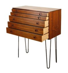 Incredible 5 drawer Danish Modern chest of drawers on 24in tall hairpin legs. Beautiful graining on rosewood. Nice half open circle drawer pulls. ..