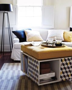 Cushion-Topped Ottoman - thinking I may try this but with crates.  Don't know if you could sit on it, but would still be great storage!