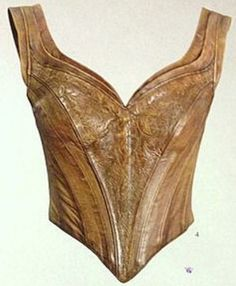 """Awesome details of the leather bodice from WETA's """"Cloaks and Daggers"""" book."""