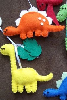 Use children's picture books to give you ideas to create gorgeous dinosaurs out of felt such as these. Your imagination can run wild and your child or children will have many hours of fun playing with them. You will have had the satisfaction of making them.   I'd make the eyes out of fabric or embroider them so there is no possibility of causing a problem with choking if buttons or something similar were used.