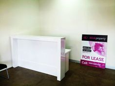 Reception counter for  real estate. White gloss