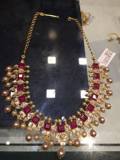 35 GMs net necklace in modern style with rubies in square shape and south sea pearls all over the necklace.Mossainites added alternative tot he ruby stones. Ruby Jewelry, India Jewelry, Gold Jewelry, Stone Jewelry, Diamond Jewelry, Beaded Jewelry, Indian Wedding Jewelry, Bridal Jewelry, Gold Jewellery Design