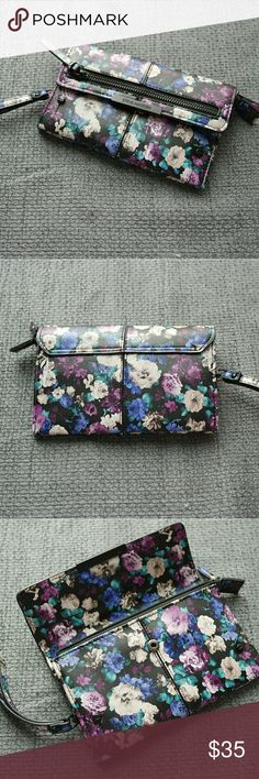 """Steve Madden Floral Wallet Wristlet Authentic Steve Madden Watercolor floral Wristlet wallet. Dimensions are 8"""" W x 4"""" H with removable  wrist strap. The exterior has one zipper pocket across with a front snap closure. The interior has 8 credit card slots, 2 compartments, and a zipper pocket. All zippers work properly. This wristlet is like new and have been used a few times. Steve Madden Accessories Key & Card Holders"""