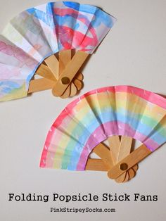 Make a folding popsicle stick fan! A creative way to keep the kids busy and cool this summer.