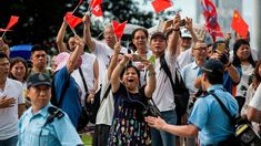 The pro-Beijing protesters waved Chinese flags to oppose the city's huge anti-extradition rallies. Joshua Wong, Social Order, Stand Down, Image Caption, Beijing, Rally, Flags, Hong Kong, Police