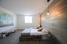 Mid century condo remodel by Joel Contreras Love the weathered paneling and flooring with the industrial pendants