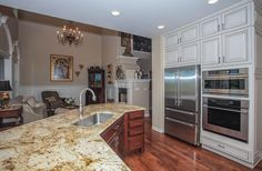 Recently sold: $720,000. ABSOLUTELY STUNNING 3 BEDROOM, 3.5 BATHROOM LUXURY TOWNHOUSE THAT BACKS TO OPEN SPACE LOCATED IN THE HIGHLY DESIRABLE TRESANA COMMUNITY IN HIGHLANDS RANCH*PREMIUM SETTING WITH EXPANSIVE MOUNTAIN VIEWS FROM ALL 3 LEVELS*HIGH END FINISHES THROUGHOUT*GOURMET DREAM KITCHEN W/SLAB GRANITE COUNTERS, HIGH END SS APPLIANCES, UNDER CABINET LIGHTING, ANTIQUE-GLAZED CABINETRY W/ GLASS FRONTS,PULL OUTS IN CABINETS*CROWN MOULDING*GLEAMING HARDWOOD FLOORS*FIREPLACE*FINISH...