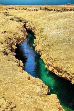 Sharm el Sheikh, South Sinai, Egypt Crack formed by ancient earthquake Ras Mohamed National Park.