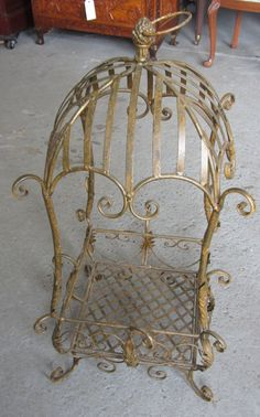 Wrought iron hanging basket on LiveAuctioneers Wrought Iron Decor, Storybook Cottage, New Orleans Homes, Wire Crafts, Garden Accessories, Hanging Baskets, Interior Decorating, Auction, Design Inspiration