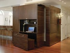 Savvy home office with a wooden bench that disappears into the unit