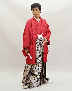 """Tumblr kimononagoya:  This high formal kimono is paired with a rare pattern of dragons. All the colors in this outfit are considered """"kimono neutral"""", including the red and white. Note that the hem of the hakama is exceptionally long, almost touching the floor while standing—like women's kimono, long hakama for men is extra formal."""