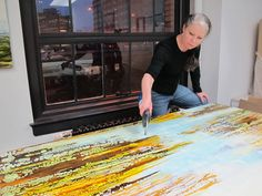 Alicia Tormey working with a torch on an encaustic piece ...Go Big!