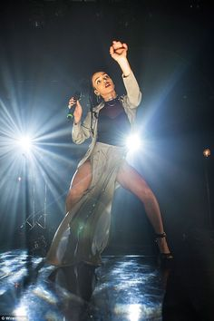 Showing what she's got: FKA twigs sashays on stage in a silky maxi skirt featuring deep slips