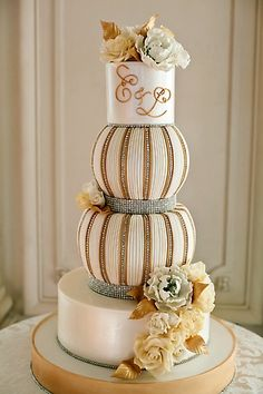 Gold and white wedding cake with Monogram.