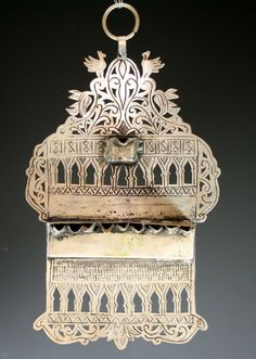 "WALL CHANUKAH LAMP. Morocco, c. 1880. Hand cut. Decorated with birds and architectural form. 9"" tall."