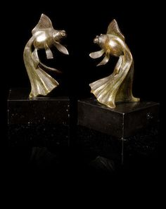 Georges-Raoul Garreau (French, born 1885) A Pair of Art Deco Fish Bookends, circa 1925