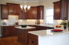 like the 2 levels, dark cabinets, light counter top