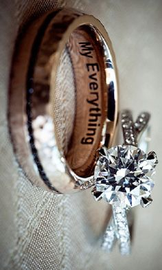 I really like this ring. I think the two bands, with the single diamond on the front. Also like the four prong setting. Would prefer just one diamond with engraving I think, vs. lots of small diamonds. Also the inscription on the guys ring is neat too.