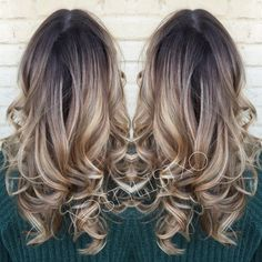 This hairstyle is a beautiful blonde to ash ombre and  styled in big curls. Take this How To to your stylist for your next night out romp.