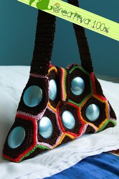 Not in English, but this site has so many recycled items with crochet and soda cans/tabs!  Wow!