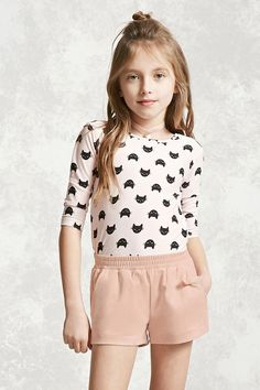 Forever 21 Girls - A pair of faux suede shorts featuring slanted pockets and a smocked elasticized waist.