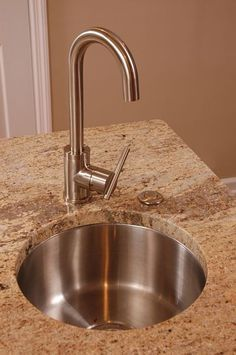 Stainless steel bar sink on kitchen island. Kitchen remodel by Neal's Design Remodel.