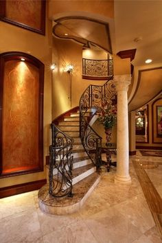 Traditional Staircase with Wall sconce, High ceiling, Columns, complex marble floors, Balcony