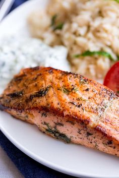This delicious and easy Greek Salmon is the perfect quick healthy dinner for the whole family. The marinade is a simple mix of olive oil, lemon, dill, and oregano. The fish is pan-fried, giving it a wonderfully crisp exterior and meltingly tender and succulent center. Perfect for serving with orzo and a Greek salad. Transport your self to Greece with the traditional and authentic recipe for Greek Salmon! Greek Recipes, Fish Recipes, Seafood Recipes, Cooking Recipes, Delicious Salmon Recipes, Grilled Salmon Recipes, Orzo, Greek Salmon Recipe, Eating Clean