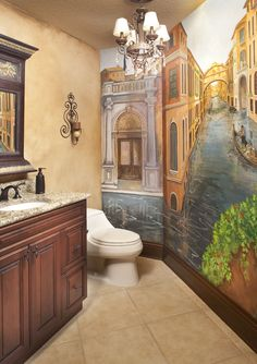 This elegant Mediterranean decorated guest bathroom boast custom lighting and…