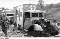 Destroyed  medical supplies truck . Western front.Near Arnheim. Holland 23 September 1944