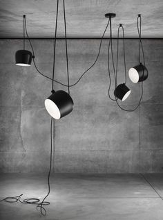 The AIM lamps' power cables double as a tactile, decorative element. Photo courtesy of Flos.