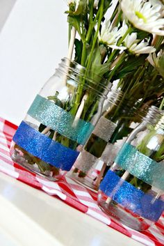 Glitter Mason Jar Vases- Ooh!  Do I want silver mason jars or glittered ones?  Or maybe they should be both silver and glittered!