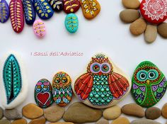My #owl family in nature, under the mandala sun - #paintedstone https://www.facebook.com/ISassiDelladriatico