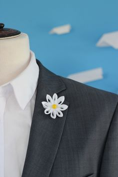 A personal favourite from my Etsy shop https://www.etsy.com/listing/398246781/white-daisy-lapel-flower-pin-white