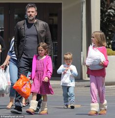 Daddy duty: It has been reported that couple are spending more and more time apart, Affleck, 42, is seen in Pacific Palisades on Sunday with the couple's three childrenViolet, nine, Seraphina, six and Samuel, three