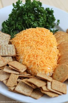 Make a cheese ball in the shape of a carrot, and sprinkle cheddar on top to make it orange.