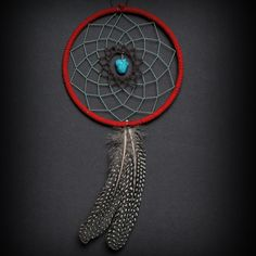 Turquoise, Brown, and Red Two Feather Small Dream Catcher. $24.00, via Etsy.