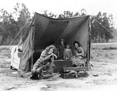 Dust Bowl...(Migrant mother, aged thirty-two with seven hungry children, Nipomo, CA )Courtesy of Library of Congress